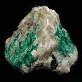 Beryl (variety emerald), Calcite<br />La Pita mining district, Municipio Maripí, Western Emerald Belt, Boyacá Department, Colombia<br />7cm across<br /> (Author: Fiebre Verde)