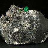 Beryl (variety emerald), Calcite<br />La Pita mining district, Municipio Maripí, Western Emerald Belt, Boyacá Department, Colombia<br />83x27x62mm, xl=9mm<br /> (Author: Fiebre Verde)