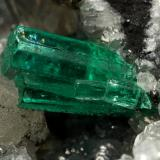 Beryl (variety emerald), Calcite, Pyrite<br />La Pita mining district, Municipio Maripí, Western Emerald Belt, Boyacá Department, Colombia<br />54x36x60mm, xl=8mm<br /> (Author: Fiebre Verde)