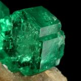 Beryl (variety emerald), Calcite<br />Muzo mining district, Western Emerald Belt, Boyacá Department, Colombia<br />60x47x49mm, central xl=16mm<br /> (Author: Fiebre Verde)