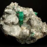 Beryl (variety emerald), Calcite<br />La Pita mining district, Polveros Mine, Municipio Maripí, Western Emerald Belt, Boyacá Department, Colombia<br />110x85x85mm, xl=30mm<br /> (Author: Fiebre Verde)
