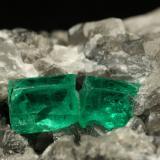 Beryl (variety emerald), Calcite<br />La Pita mining district, Municipio Maripí, Western Emerald Belt, Boyacá Department, Colombia<br />60x55x80mm, xl=6+8mm<br /> (Author: Fiebre Verde)