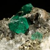 Beryl (variety emerald), Calcite, Pyrite, Albite (variety cleavelandite)<br />Chivor mining district, Municipio Chivor, Eastern Emerald Belt, Boyacá Department, Colombia<br />70x46x34mm, main xl=18mm<br /> (Author: Fiebre Verde)
