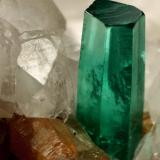Beryl (variety emerald), Calcite, Parisite<br />La Pita mining district, Municipio Maripí, Western Emerald Belt, Boyacá Department, Colombia<br />8x8x8cm, H35mm, xl=8mm<br /> (Author: Fiebre Verde)