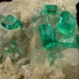 Beryl (variety emerald), Calcite, Dolomite<br />La Pita mining district, Cunas Mine, Municipio Maripí, Western Emerald Belt, Boyacá Department, Colombia<br />42x39x34mm, xls up to 7mm<br /> (Author: Fiebre Verde)