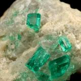 Beryl (variety emerald), Calcite<br />La Pita mining district, Cunas Mine, Municipio Maripí, Western Emerald Belt, Boyacá Department, Colombia<br />42x39x34mm, xls up to 7mm<br /> (Author: Fiebre Verde)