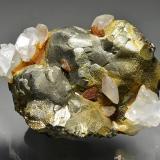 Pyrite, calcite.<br />Stan Terg Mine, Trep&#269;a Complex, Trep&#269;a Valley, Kosovska Mitrovica, Kosovska Mitrovica District, Kosovo<br />7.5 x 6.5 x 6 cm.<br /> (Author: Martin Rich)