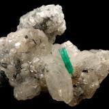 Beryl (variety emerald), Calcite<br />La Pita mining district, Polveros Mine, Municipio Maripí, Western Emerald Belt, Boyacá Department, Colombia<br />35x64x49mm, xl=12mm<br /> (Author: Fiebre Verde)