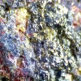 Harzburguita Barranco de Guayedra, Las Palmas de Gran Canaria, España 60X Es llamativo que los cristales de olivino son mucho mayores que los cristales de piroxeno de la matriz (microcristalina). (Autor: prcantos)