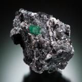 Beryl (variety emerald), Calcite, Pyrite<br />Coscuez mining district, Municipio San Pablo de Borbur, Western Emerald Belt, Boyacá Department, Colombia<br />38x35x38mm, xl=5x5mm<br /> (Author: Fiebre Verde)