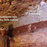 Photo 1. Note that a 1.5 metre chunk of a thin sandstone lens just below the hanging wall has been picked by a thrust fault and dragged along to be placed over the right hand continuation of the lens. And mining maiden takes a well-earned break. (Author: crocoite)