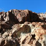 Photo 7. Sandstone rotated from near horizontal to vertical in a crush zone rich in copper oxides. (Author: crocoite)