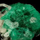 Beryl (variety emerald), Calcite, Quartz<br />Muzo mining district, Western Emerald Belt, Boyacá Department, Colombia<br />53x39mm, xl=25x23mm<br /> (Author: Fiebre Verde)