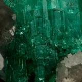 Beryl (variety emerald), Calcite, Quartz<br />La Pita mining district, Municipio Maripí, Western Emerald Belt, Boyacá Department, Colombia<br />21x35mm, cluster=20mm long<br /> (Author: Fiebre Verde)