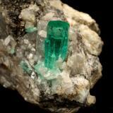 Beryl (variety emerald), Calcite<br />Coscuez mining district, Municipio San Pablo de Borbur, Western Emerald Belt, Boyacá Department, Colombia<br />30x49x29mm, xl=9x4mm<br /> (Author: Fiebre Verde)