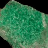 Beryl (variety emerald), Calcite<br />La Pita mining district, Municipio Maripí, Western Emerald Belt, Boyacá Department, Colombia<br />47x24x34mm<br /> (Author: Fiebre Verde)