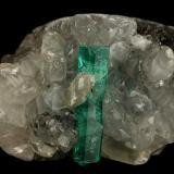 Beryl (variety emerald), Calcite<br />La Pita mining district, Cunas Mine, Municipio Maripí, Western Emerald Belt, Boyacá Department, Colombia<br />31x21x20mm, xl=16x4mm<br /> (Author: Fiebre Verde)