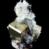 Tetrahedrite, Pyrite, Quartz, Sphalerite<br />Mundo Nuevo mining area, Mundo Nuevo, Huamachuco, Sánchez Carrión Province, La Libertad Department, Peru<br />77 mm x 71 mm x 54 mm. Tetrahedrite crystal: 24 mm on edge. Major pyrite crystal: 26 mm on edge<br /> (Author: Carles Millan)